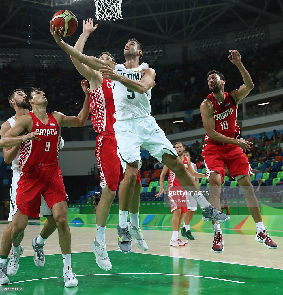 Mantas Kalnietis of Lithuania is challenged by Miro Bilan of Croatia and Roko Ukic of Croatia during a Men's Basketball Preliminary Round Group B game between Lithuania and Croatia on August 15, 2016 in Rio de Janeiro, Brazil.