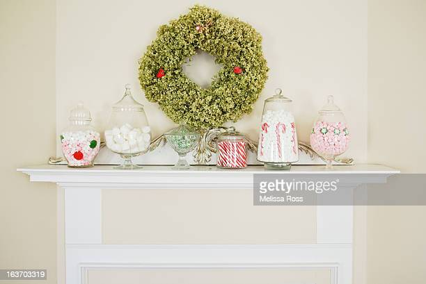 Mantel decorated with candy filled apothecary jars