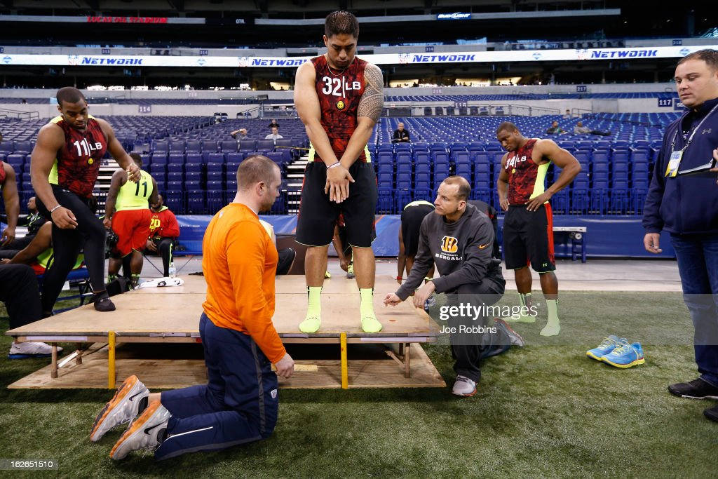 Manti Te'o of Notre Dame has measurements taken with other linebackers during the 2013 NFL Combine at Lucas Oil Stadium on February 25, 2013 in Indianapolis, Indiana.