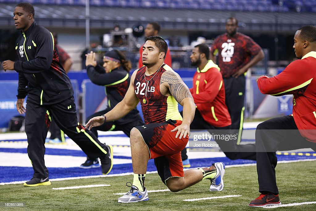 Manti Te'o of Notre Dame stretches with other linebackers during the 2013 NFL Combine at Lucas Oil Stadium on February 25 2013 in Indianapolis Indiana