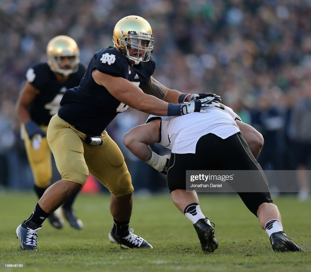 Manti T'eo of the Notre Dame Fighting Irish moves around Whit Barnes of the Wake Forest Demon Deacons at Notre Dame Stadium on November 17 2012 in...