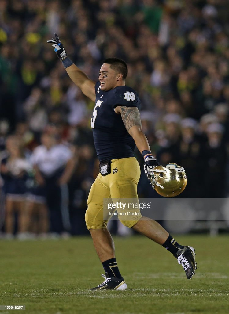 Manti T'eo of the Notre Dame Fighting Irish waves to the crowd as he leaves the home field for the last time during a game against the Wake Forest...