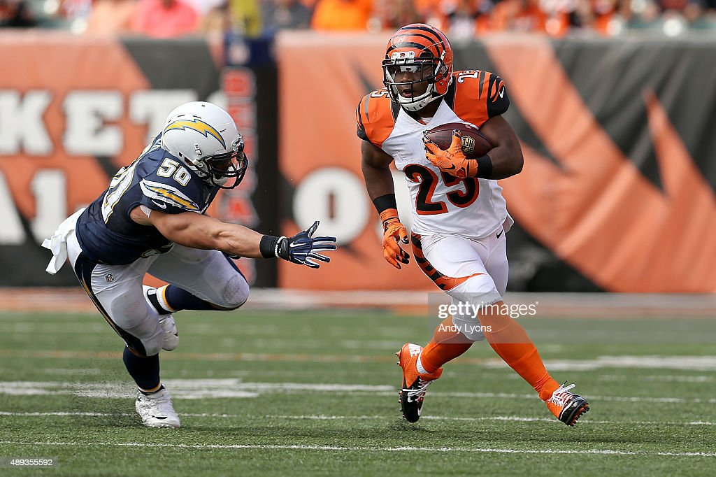 Manti Te'o of the San Diego Chargers attempts to tackle Giovani Bernard of the Cincinnati Bengals during the third quarter at Paul Brown Stadium on...