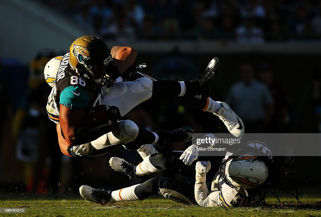 ... Manti Teo 50 of the San Diego Chargers tackles Clay Harbor 86 ... 00399d338
