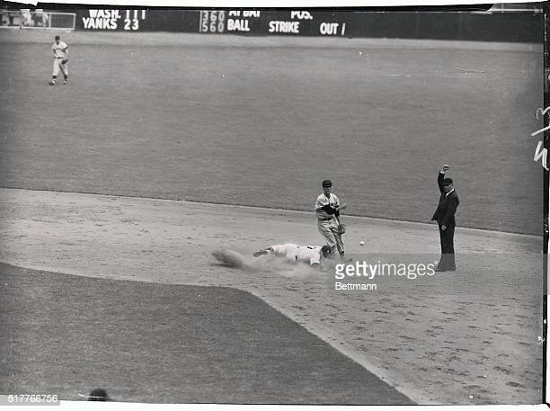 Mantle of the Yankees is forced at second base as Collins grounds into a double play in the third inning of today's game with the Washington senators...
