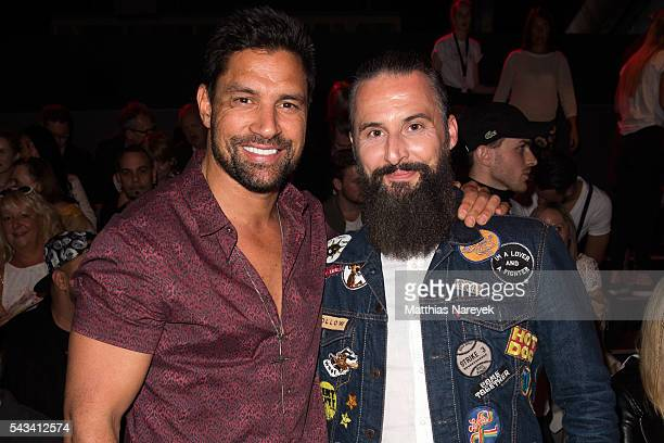 Manu Bennett and Tobias Bojko attend the Thomas Hanisch show during the MercedesBenz Fashion Week Berlin Spring/Summer 2017 at Erika Hess Eisstadion...