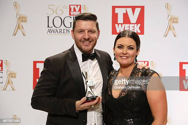 Manu Feildel and Karen Martini pose in the awards room after winning a Logie for Most Popular Reality Program at the 2014 Logie Awards at Crown...