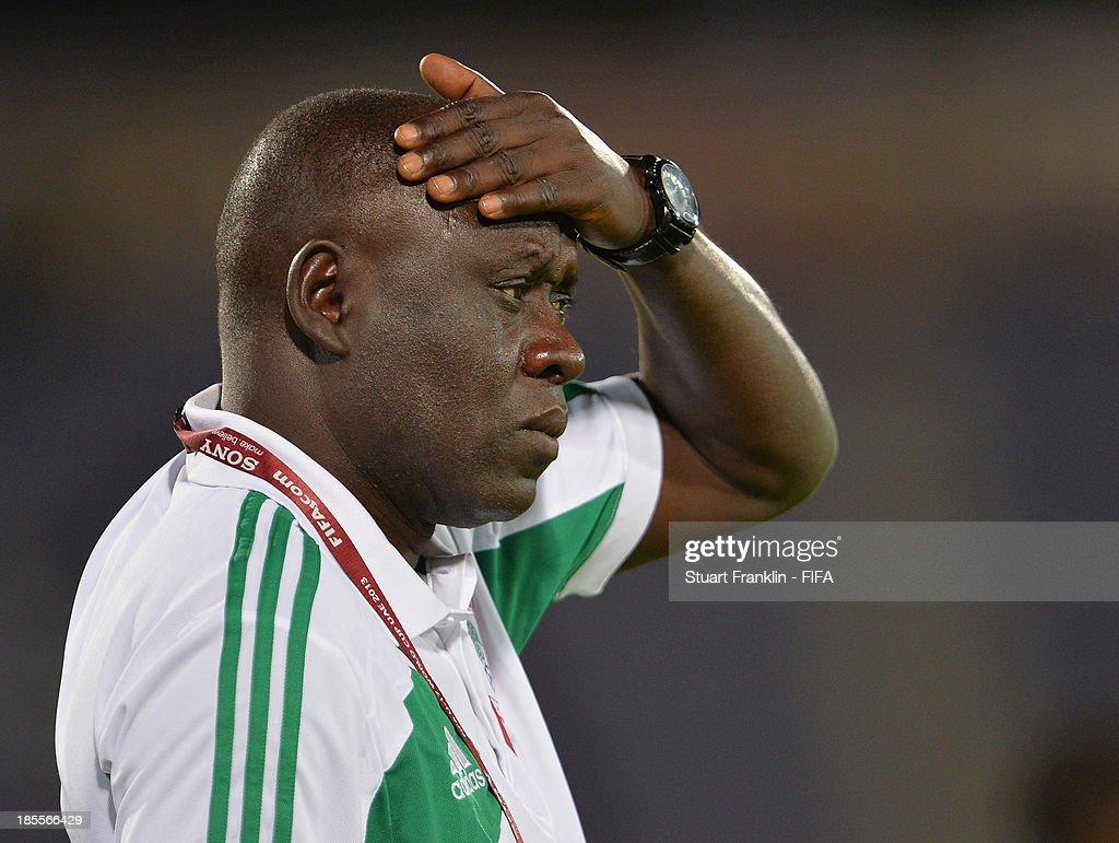 Manu Garba, head coach of Nigeria ponders during the FIFA U17 group F match between Sweden and Nigeria at Khalifa Bin Zayed Stadium on October 22, 2013 in Al Ain, United Arab Emirates.