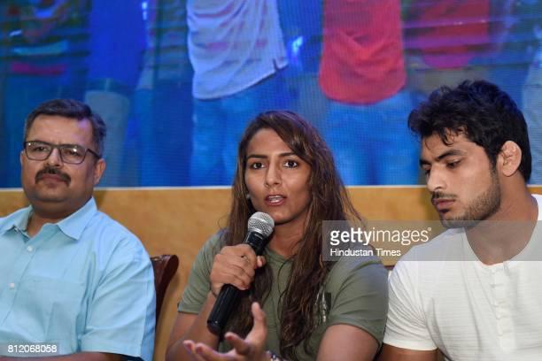 Manu Gaur President TAXAB Freesty le wrestler Geeta Phogat Wrestler Pawan Saroha talk at the press conference on July 10 2017 in New Delhi India...