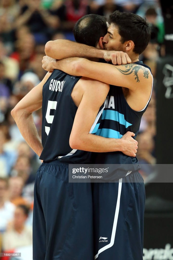 Manu Ginobili #5 and <a gi-track='captionPersonalityLinkClicked' href=/galleries/search?phrase=Carlos+Delfino&family=editorial&specificpeople=206625 ng-click='$event.stopPropagation()'>Carlos Delfino</a> #10 of Argentina celebrate late in the fourth quarter before Argentina's 82-77 victory against Brazil during the Men's Basketball quaterfinal game on Day 12 of the London 2012 Olympic Games at North Greenwich Arena on August 8, 2012 in London, England.