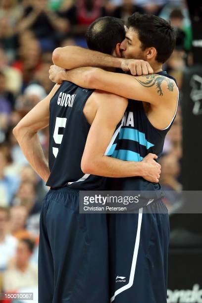 Manu Ginobili and Carlos Delfino of Argentina celebrate late in the fourth quarter before Argentina's 8277 victory against Brazil during the Men's...