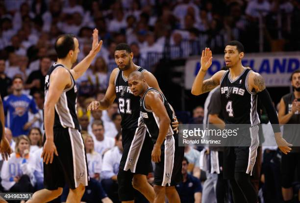 Manu Ginobili and Danny Green of the San Antonio Spurs celebrate with their teammates after a play against the Oklahoma City Thunder in the second...