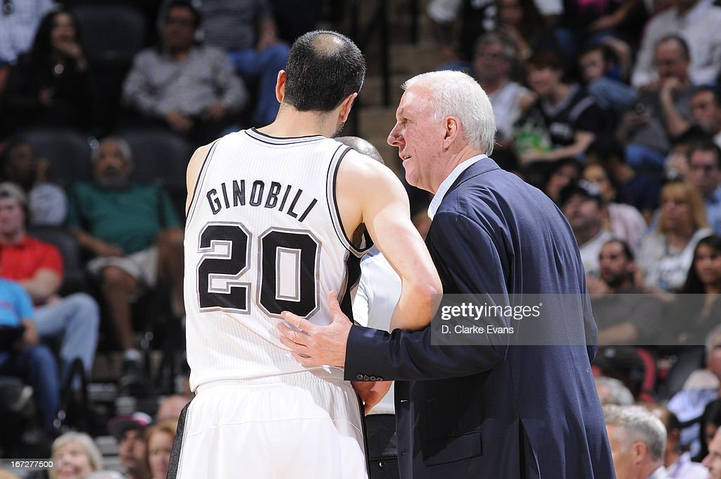 Manu Ginobili #20 and <a gi-track='captionPersonalityLinkClicked' href=/galleries/search?phrase=Gregg+Popovich&family=editorial&specificpeople=202904 ng-click='$event.stopPropagation()'>Gregg Popovich</a> of the San Antonio Spurs talk on the bench during the game against the Golden State Warriors on March 20, 2013 at the AT&T Center in San Antonio, Texas.