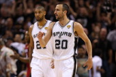 Manu Ginobili and Tim Duncan of the San Antonio Spurs celebrate in the third quarter while taking on the Miami Heat during Game Three of the 2013 NBA...