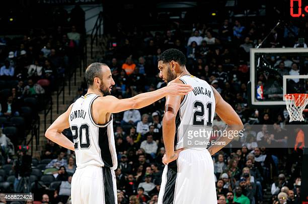 Manu Ginobili and Tim Duncan of the San Antonio Spurs speak during a game against the Atlanta Hawks at the ATT Center on November 5 2014 in San...