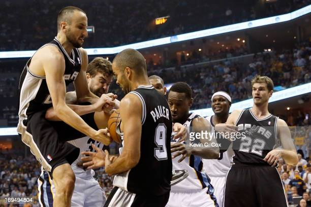 Manu Ginobili and Tony Parker of the San Antonio Spurs go for the ball against Marc Gasol of the Memphis Grizzlies in the fourth quarter during Game...