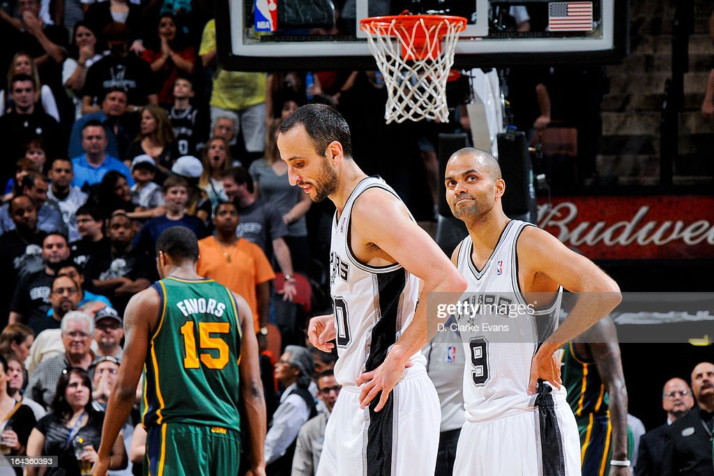 Manu Ginobili #20 and Tony Parker #9 of the San Antonio Spurs wait to resume game action against the Utah Jazz on March 22, 2013 at the AT&T Center in San Antonio, Texas.