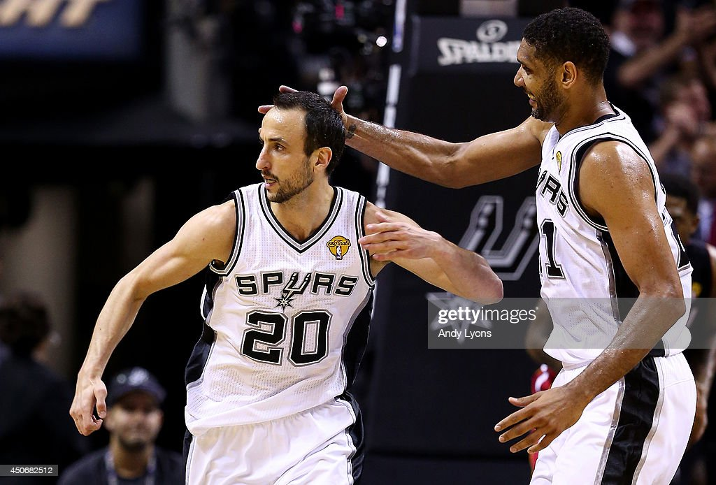 Manu Ginobili #20 celebrates with <a gi-track='captionPersonalityLinkClicked' href=/galleries/search?phrase=Tim+Duncan&family=editorial&specificpeople=201467 ng-click='$event.stopPropagation()'>Tim Duncan</a> #21 of the San Antonio Spurs after hitting a shot against the Miami Heat during Game Five of the 2014 NBA Finals at the AT&T Center on June 15, 2014 in San Antonio, Texas.