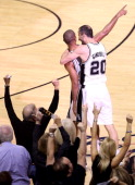 Manu Ginobili hugs Gary Neal of the San Antonio Spurs after Neal makes a threepointer at the end of the second quarter while taking on the Miami Heat...