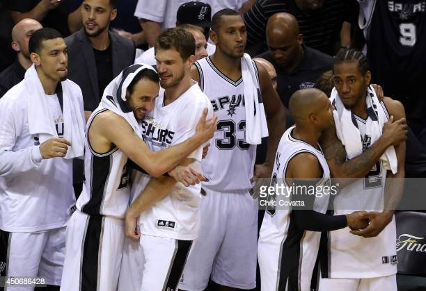Manu Ginobili hugs Tiago Splitter of the San Antonio Spurs during Game Five of the 2014 NBA Finals against the Miami Heat at the ATT Center on June...