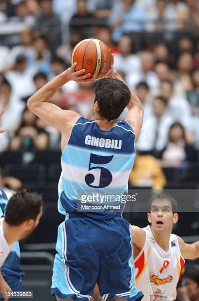 Manu Ginobili makes the jumper as Jose Manuel Calderon of Spain is grounded during the FIBA World Championship 2006 Semi Final at the Saitama Super...