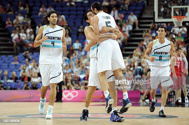 Manu Ginobili of Argentina celebrates making a three pointer during the Men's Basketball bronze medal game between Russia and Argentina on Day 16 of...