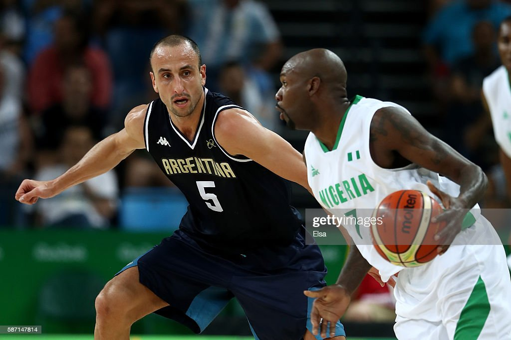 Manu Ginobili of Argentina defends against AlFarouq Aminu of Nigeria during a Men's preliminary round basketball game between Nigeria and Argentina...