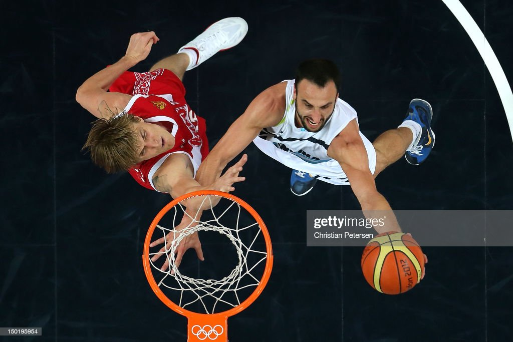 Manu Ginobili #5 of Argentina drives to the basket against Andrey Kirilenko #15 of Russia during the Men's Basketball bronze medal game between Russia and Argentina on Day 16 of the London 2012 Olympics Games at North Greenwich Arena on August 12, 2012 in London, England.