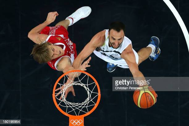 Manu Ginobili of Argentina drives to the basket against Andrey Kirilenko of Russia during the Men's Basketball bronze medal game between Russia and...