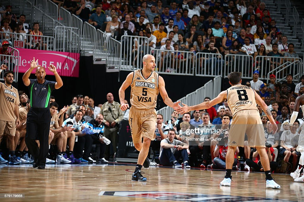 Manu Ginobili of Argentina high fives Nicolas Laprovittola of Argentina during the game against the USA Basketball Men's National Team on July 22...