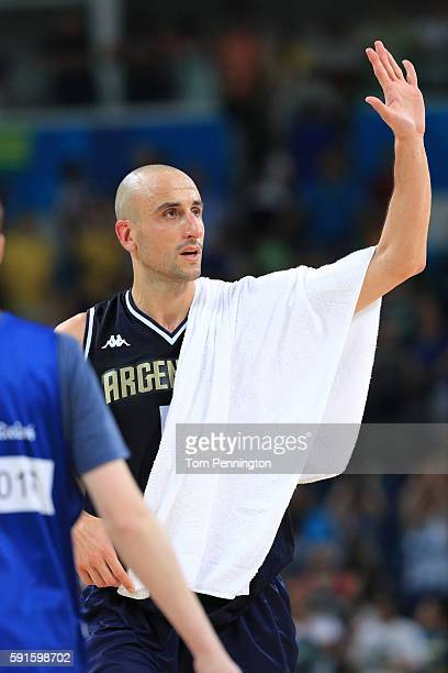 Manu Ginobili of Argentina waves to the fans after losing to the United States during the Men's Basketball Quarterfinal game at Carioca Arena 1 on...