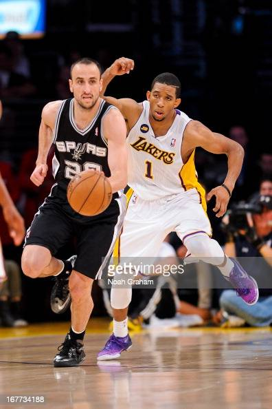 Manu Ginobili of the San Antonio Spurs advances the ball against Darius Morris of the Los Angeles Lakers in Game Four of the Western Conference...