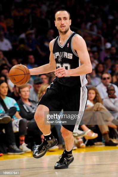 Manu Ginobili of the San Antonio Spurs advances the ball against the Los Angeles Lakers in Game Four of the Western Conference Quarterfinals during...