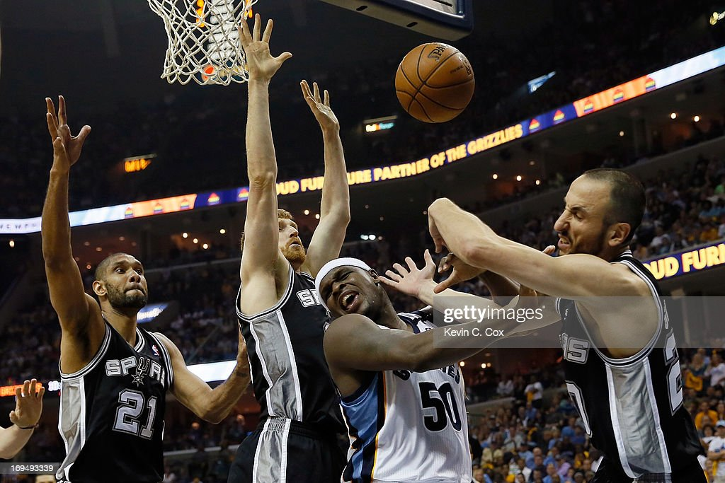 Manu Ginobili #20 of the San Antonio Spurs and <a gi-track='captionPersonalityLinkClicked' href=/galleries/search?phrase=Zach+Randolph&family=editorial&specificpeople=201595 ng-click='$event.stopPropagation()'>Zach Randolph</a> #50 of the Memphis Grizzlies battle for the ball in the second half during Game Three of the Western Conference Finals of the 2013 NBA Playoffs at the FedExForum on May 25, 2013 in Memphis, Tennessee.