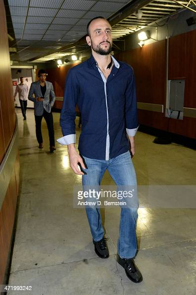 Manu Ginobili of the San Antonio Spurs arrives at the arena before a game against the Los Angeles Clippers in Game Seven of the Western Conference...