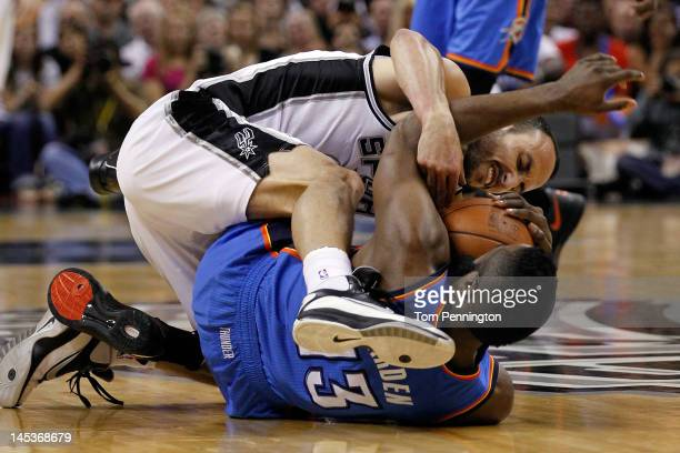 Manu Ginobili of the San Antonio Spurs battles for the ball on the floor with James Harden of the Oklahoma City Thunder in the first quarter in Game...