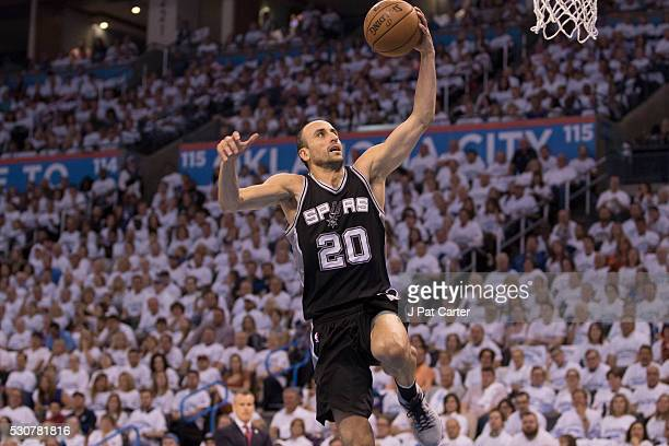 Manu Ginobili of the San Antonio Spurs brings the ball up court against the Oklahoma City Thunder during Game Four of the Western Conference...