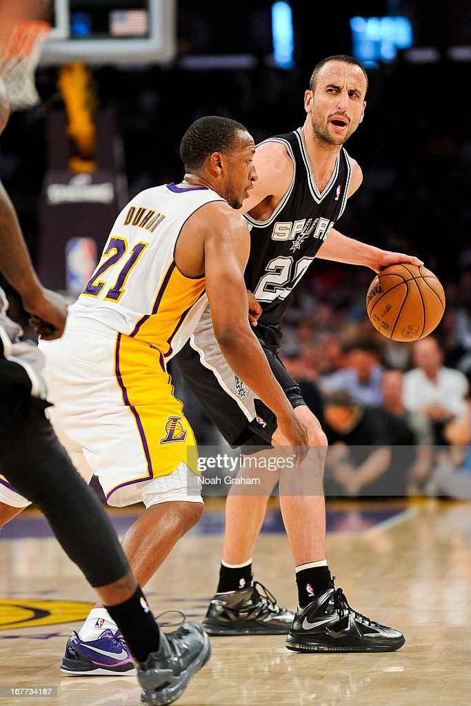Manu Ginobili #20 of the San Antonio Spurs calls out a play to his teammates against Chris Duhon #21 of the Los Angeles Lakers in Game Four of the Western Conference Quarterfinals during the 2013 NBA Playoffs at Staples Center on April 28, 2013 in Los Angeles, California.