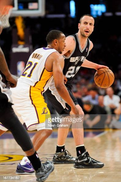 Manu Ginobili of the San Antonio Spurs calls out a play to his teammates against Chris Duhon of the Los Angeles Lakers in Game Four of the Western...