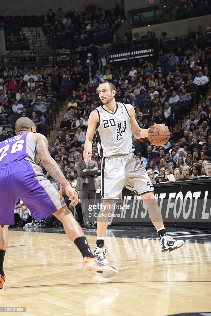 Manu Ginobili #20 of the San Antonio Spurs controls the ball against Shannon Brown #26 of the Phoenix Suns on January 26, 2013 at the AT&T Center in San Antonio, Texas.