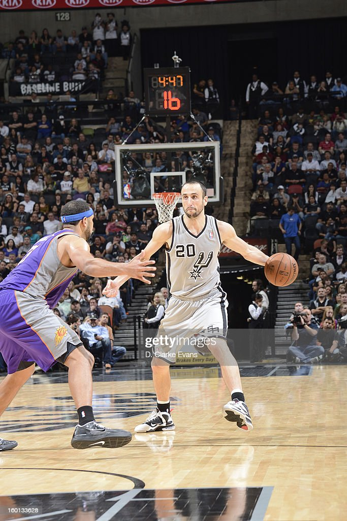 Manu Ginobili #20 of the San Antonio Spurs controls the ball against Jared Dudley #3 of the Phoenix Suns on January 26, 2013 at the AT&T Center in San Antonio, Texas.