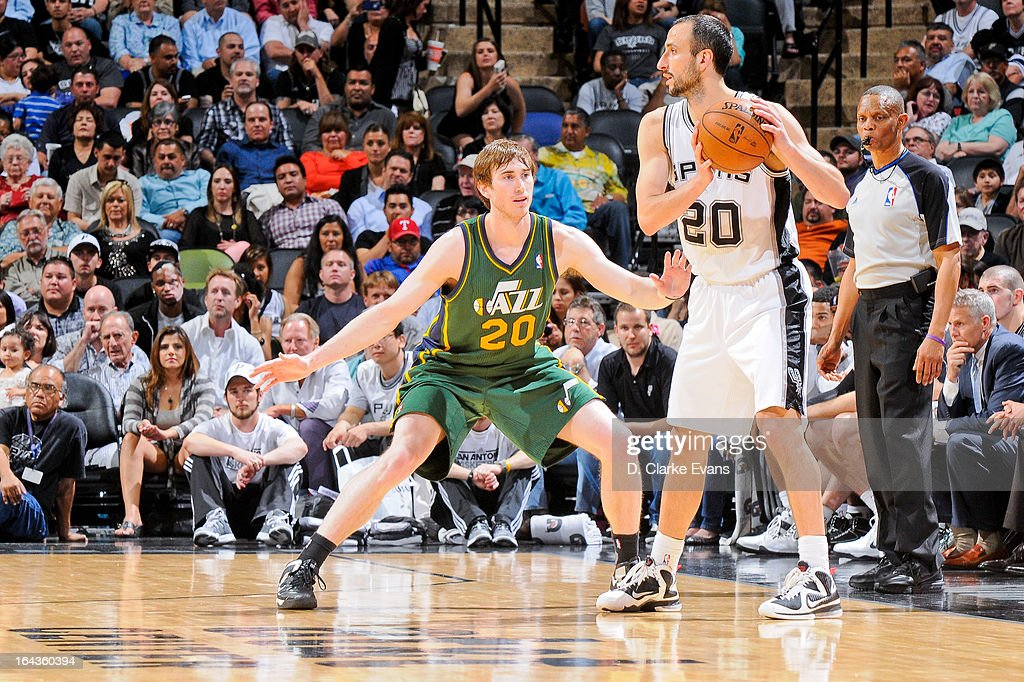Manu Ginobili #20 of the San Antonio Spurs controls the ball against Gordon Hayward #20 of the Utah Jazz on March 22, 2013 at the AT&T Center in San Antonio, Texas.