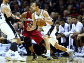 Manu Ginobili of the San Antonio Spurs controls the ball as Ray Allen of the Miami Heat defends during Game One of the 2014 NBA Finals at the ATT...