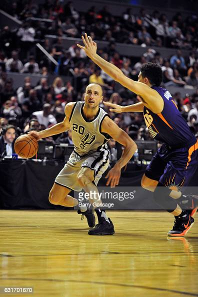 Manu Ginobili of the San Antonio Spurs dribbles the ball against the Phoenix Suns as part of NBA Global Games at Arena Ciudad de Mexico on January 14...