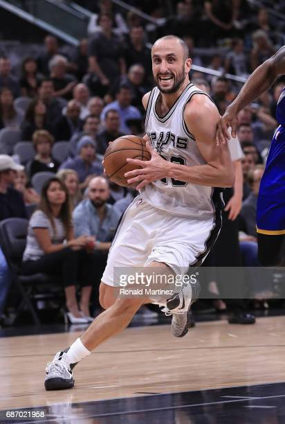 Manu Ginobili of the San Antonio Spurs dribbles the ball in the second half against the Golden State Warriors during Game Four of the 2017 NBA...