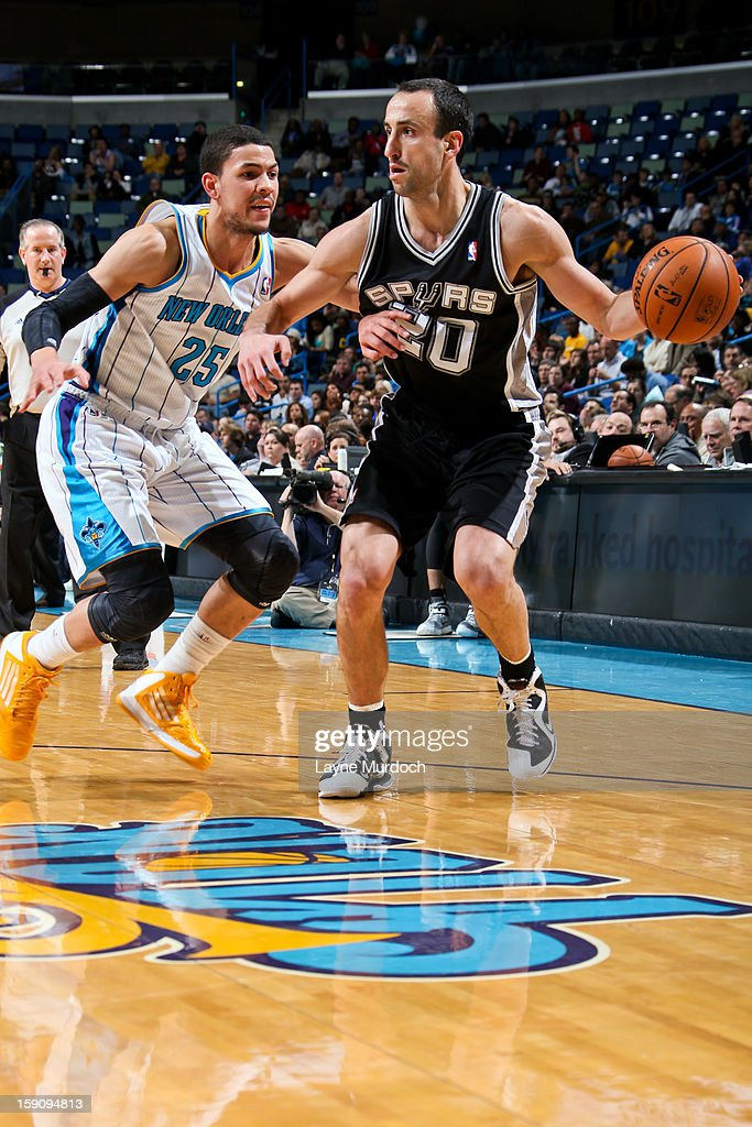 Manu Ginobili #20 of the San Antonio Spurs drives against <a gi-track='captionPersonalityLinkClicked' href=/galleries/search?phrase=Austin+Rivers&family=editorial&specificpeople=7117574 ng-click='$event.stopPropagation()'>Austin Rivers</a> #25 of the New Orleans Hornets on January 7, 2013 at the New Orleans Arena in New Orleans, Louisiana.