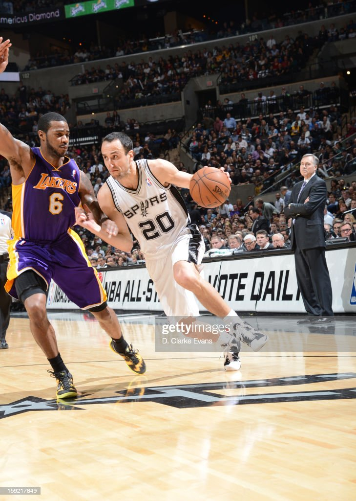 Manu Ginobili #20 of the San Antonio Spurs drives against Earl Clark #6 of the Los Angeles Lakers during the game between the Los Angeles Lakers and the San Antonio Spurs on January 9, 2013 at the AT&T Center in San Antonio, Texas.