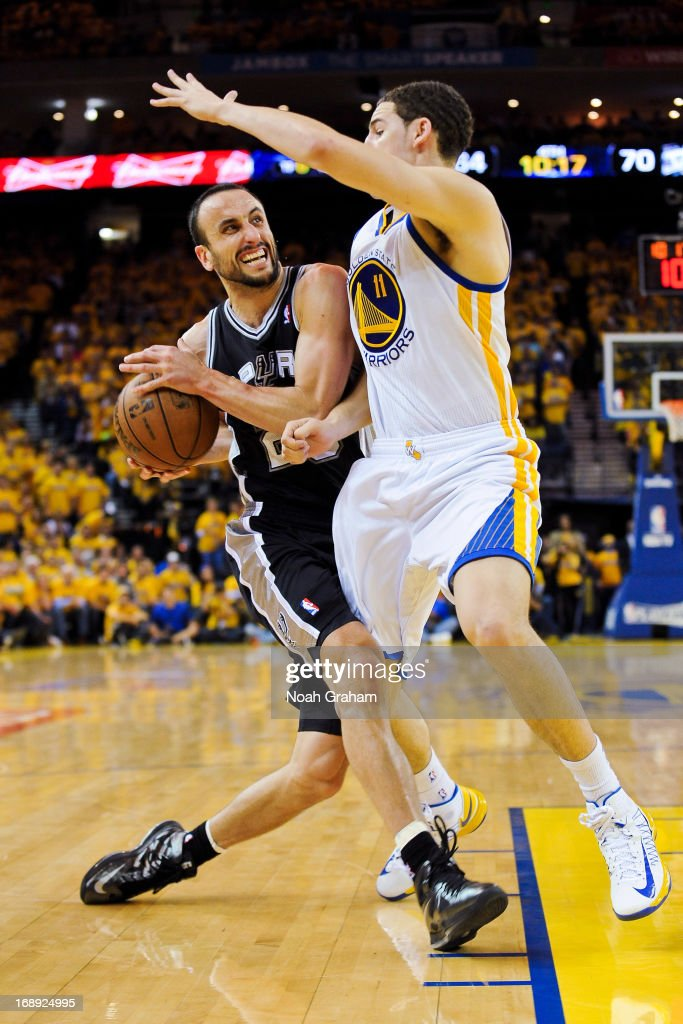 Manu Ginobili #20 of the San Antonio Spurs drives against Klay Thompson #11 of the Golden State Warriors in Game Six of the Western Conference Semifinals during the 2013 NBA Playoffs on May 16, 2013 at Oracle Arena in Oakland, California.