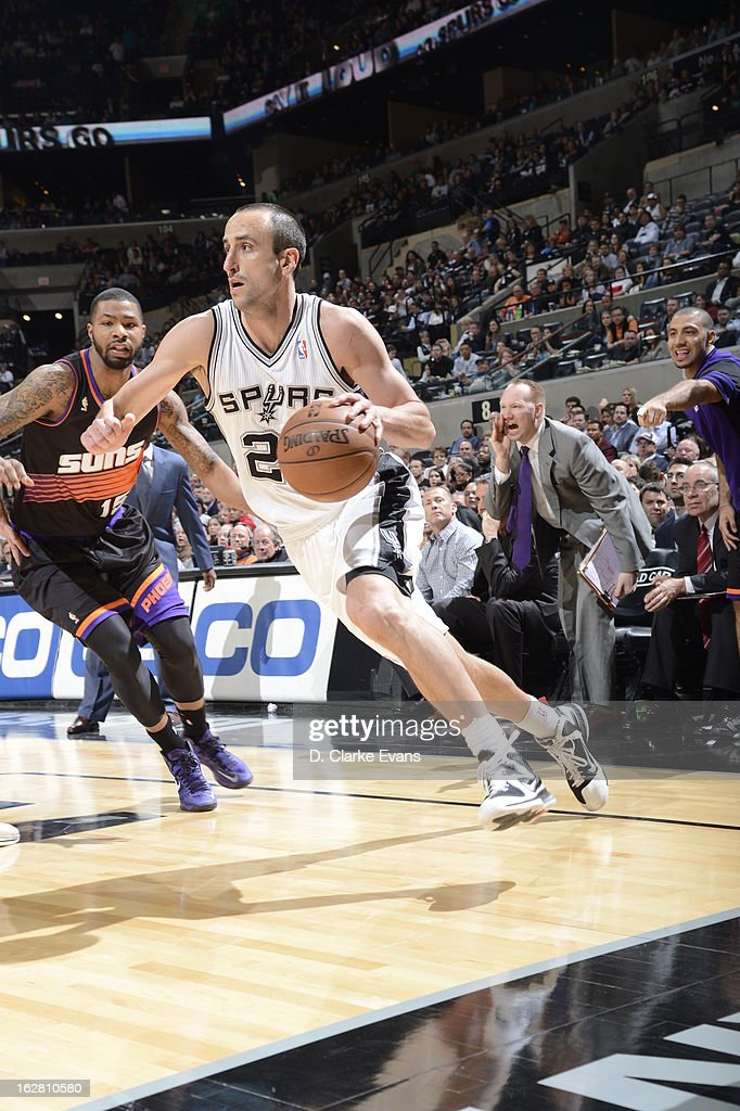 Manu Ginobili #20 of the San Antonio Spurs drives against <a gi-track='captionPersonalityLinkClicked' href=/galleries/search?phrase=Markieff+Morris&family=editorial&specificpeople=5293881 ng-click='$event.stopPropagation()'>Markieff Morris</a> #11 of the Phoenix Suns on February 27, 2013 at the AT&T Center in San Antonio, Texas.