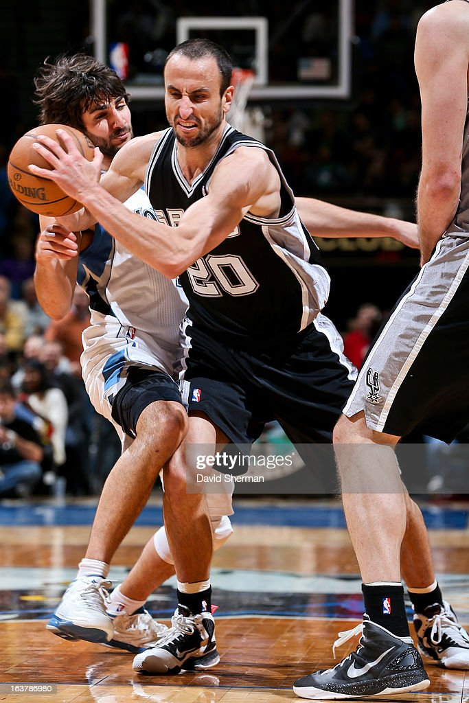 Manu Ginobili #20 of the San Antonio Spurs drives against Ricky Rubio #9 of the Minnesota Timberwolves on March 12, 2013 at Target Center in Minneapolis, Minnesota.